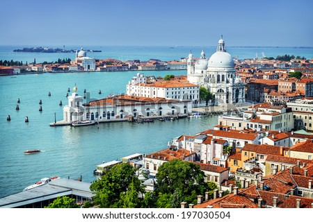 Beautiful view of the Grand Canal and Basilica Santa Maria della Salute in the late evening with very interesting clouds, Venice, Italy  #197030504