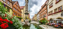 Beautiful view of the historic town of Rothenburg ob der Tauber with fountain, Franconia, Bavaria, Germany