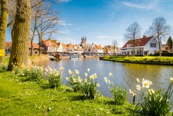 Beautiful view of the historic town of Sluis on a scenic sunny day with blue sky and clouds in spring, Zeelandic Flanders region, Netherlands