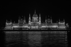 Beautiful view of the Hungarian Parliament Building at the bank of River Danube at night in Budapest, Hungary - Black and White