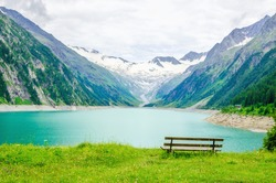 Beautiful view of the lake Schlegeis and empty desk, Zillertal Alps, Austria