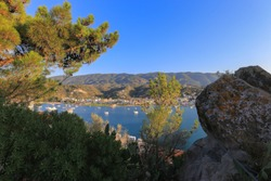 Beautiful view of the mountains and the port in Poros, Greece