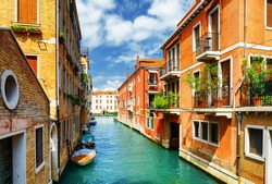 Beautiful view of the Rio Marin Canal and colorful facades of old houses from the Ponte de la Bergami in Venice, Italy. Venice is a popular tourist destination of Europe.