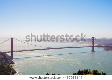 Beautiful view of the San Francisco bay with the Golden Gate view from above and a city on the background. #457058647