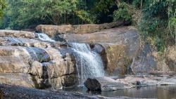 Beautiful view of the scenic Thommankuthu Waterfalls in a jungle near Thodupuzha, Kerala, India - panaoramic shot