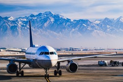 Beautiful view of the snow covered mountains from Salt Lake City whilst in the airport lounge getting ready for departure during winter.