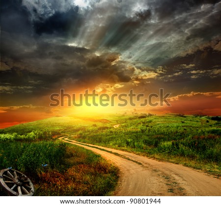 beautiful view of the sunset in a field on a rural road