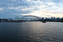 Beautiful view of the Sydney opera house and the harbour bridge at sunset