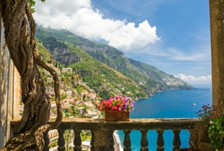 beautiful view of the town of Positano from antique terrace with flowers, Amalfi coast, Italy. balcony with flowers.
