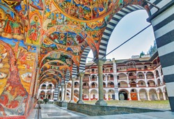 Beautiful view of the vibrant decoration of the Orthodox Rila Monastery, a famous tourist attraction and cultural heritage monument in the Rila Nature Park mountains in Bulgaria