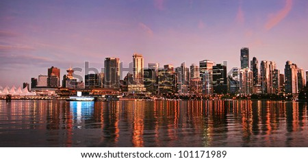 Beautiful view of Vancouver skyline at sunset as seen from Stanley Park, BC, Canada