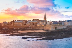 Beautiful view of walled city Saint-Malo with St Vincent Cathedral at sunrise at high tide. Saint-Maol is famous port city of Privateers is known as city corsaire, Brittany, France