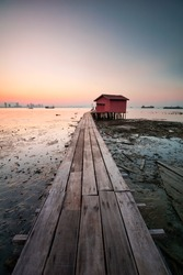 Beautiful view of wooden bridge Clan Tan Jetty view during sunrise in George Town, Penang