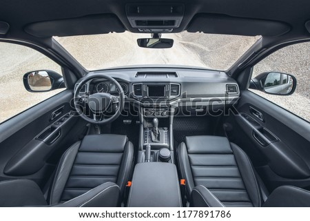 Beautiful view on canyon from inside of modern suv. Car interior with black leather and view on off road panorama.