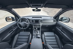 Beautiful view on canyon from inside of modern suv. Truck car interior with black leather