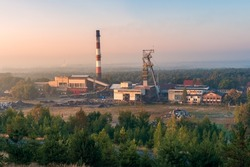 Beautiful view on coal mining 'Boze Dary' in Katowice, Silesia, Poland seen from mining heap at sunrise. Nature versus industry. A mine surrounded by forests