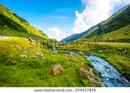 Beautiful view on mountain river on Fagaras mountains in Romania #294937898