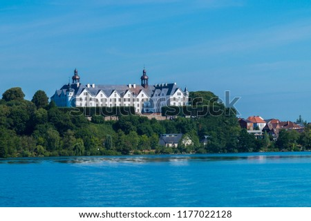 Beautiful view on the castle of ploen in germany. Taking a boat tour on the lake.