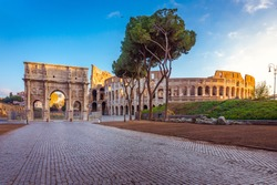 Beautiful view over Colosseum and Arch of Constantine in the morning in Rome, Italy, Europe