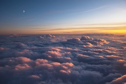 Beautiful view through the aircraft window during a sunset