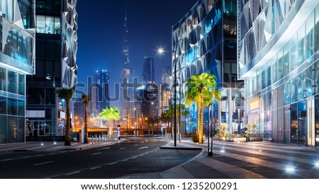 Beautiful view to Dubai downtown city center skyline from Design District at night, United Arab Emirates