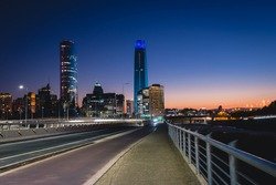 Beautiful view to road and illuminated skyscrapers in Santiago, Chile. Horizontal outdoors shot