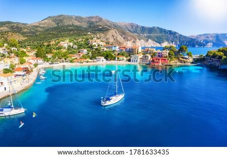 Beautiful view to the picturesque fishing village of Assos, Kefalonia, Greece, with sailing boats moored over the turquoise sea