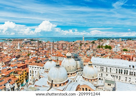 Beautiful views of the Mediterranean traditional houses Venice with red tile roofs from Campanile di San Marco. Venice, Italy, Europe