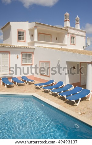 Beautiful villa a refresh water pool and sunbeds at Algarve, south of Portugal