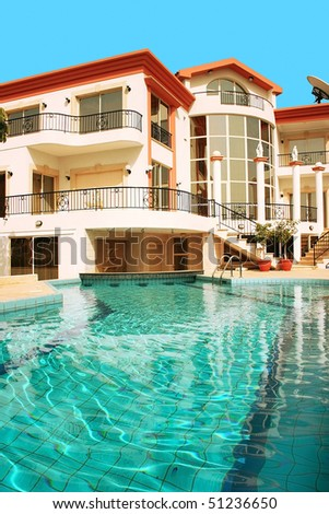 Beautiful villa with columns and swimming pool.