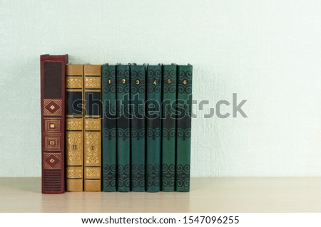 Beautiful vintage books stand on a shelf. Concept reading, classic literature
