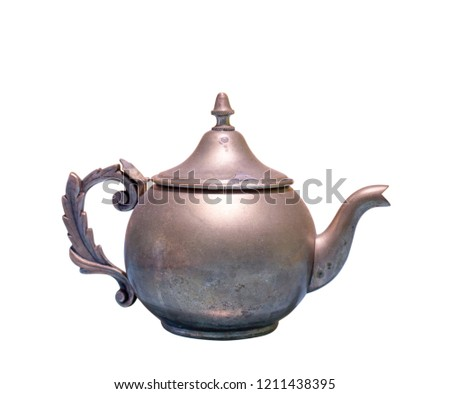 Beautiful vintage copper teapot kettle with tarnished metal, isolated in white background. Old teapot with abrasions.
