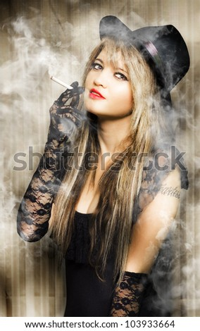 beautiful vintage girl smoking cigarette with pretty smile in a creative pinup style portrait