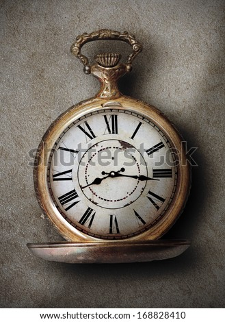 beautiful vintage hand clock on a textured background