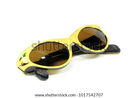 Beautiful vintage yellow sunglasses for woman closeup isolated on white. 1960s.