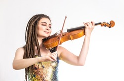 Beautiful violinist girl playing the violin