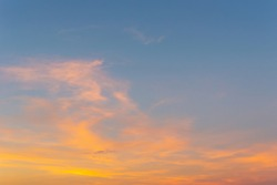 Beautiful Vivid sky painted by the sun leaving bright golden shades.Dense clouds in twilight sky in winter evening.Evening Vivid  sky with clouds.