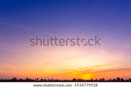 Beautiful Vivid sky painted by the sun leaving bright golden shades.Dense clouds in twilight sky in winter evening.Image of cloud sky on evening time.Evening Vivid sky with clouds. Stock photo ©