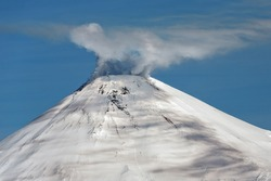 Beautiful volcanic landscape: view of snowy cone of Avachinsky Volcano - active volcano of Kamchatka Peninsula. Koryaksky-Avachinsky Group of Volcanoes, Kamchatka Region, Russian Far East, Eurasia
