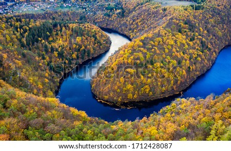 Beautiful Vyhlidka Maj, Lookout Maj, near Teletin, Czech Republic. Meander of the river Vltava surrounded by colorful autumn forest viewed from above. Tourist attraction in Czech landscape. Czechia. Stock photo ©