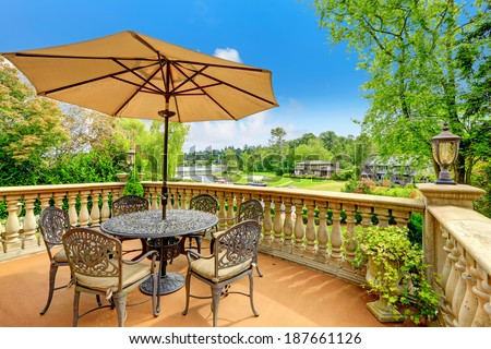Beautiful walkout deck with antique table set and umbrella. Amazing view from the deck #187661126