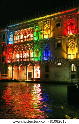 Beautiful water street at night time in color lights in Venice, Italy