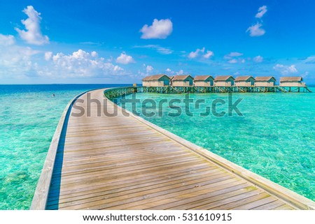 Beautiful water villas in tropical Maldives island