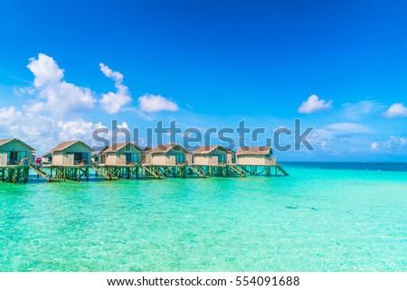 Beautiful water villas in tropical Maldives island #554091688