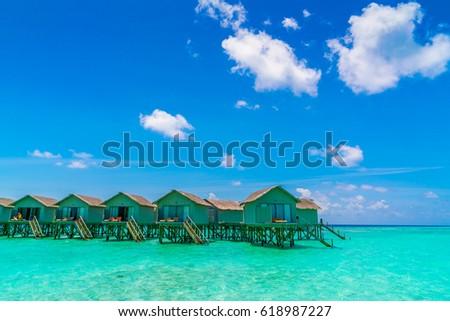 Beautiful water villas in tropical Maldives island #618987227