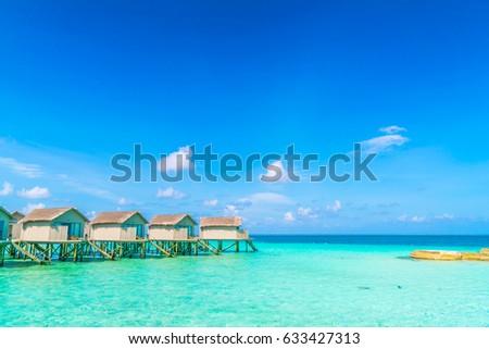 Beautiful water villas in tropical Maldives island #633427313
