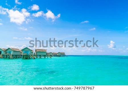 Beautiful water villas in tropical Maldives island #749787967