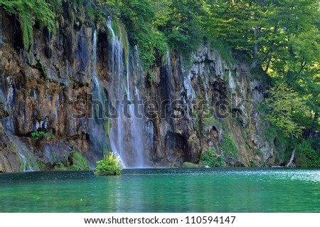 Beautiful waterfall and a turquoise lake in Plitvice, Croatia
