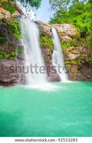 Beautiful waterfall at summer sunny day. Bali