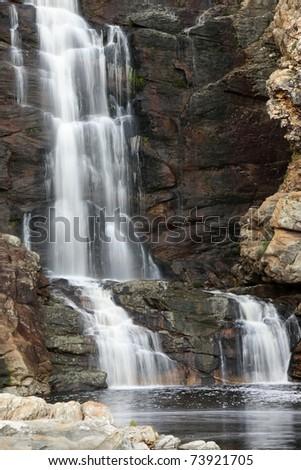 Beautiful waterfall cascading down rocks into a pool below